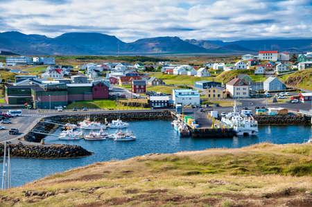 STYKKISHOLMUR, ICELAND - AUGUST 9, 2019: Stykkisholmur beautiful homes on a sunny summer afternoon.