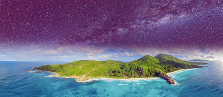Aerial panoramic view of Tropical Island at night with stars and milky way.