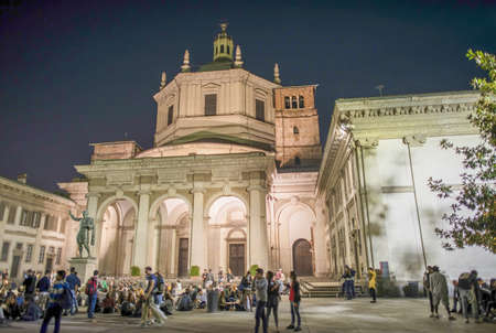 MILAN, ITALY - SEPTEMBER 2015: Tourists and locals enjoy night life near San Lorenzo.
