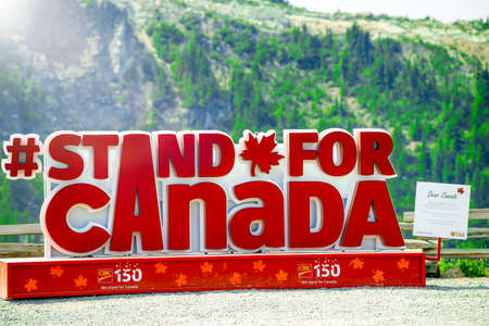 WHISTLER, CANADA - AUGUST 12, 2017: Stand for Canada sign in Whistler Mountain.