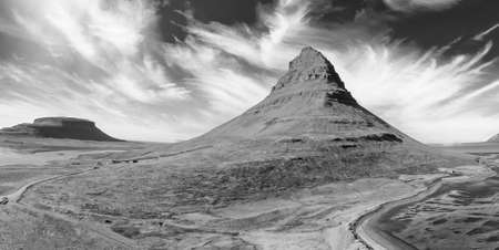 Aerial panoramic view of Kirkjufell mountain landscape at sunset in Iceland, drone viewpoint.