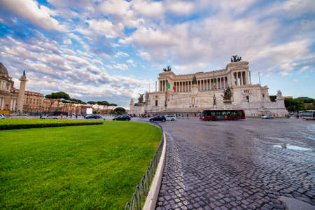 ROME, ITALY - JUNE 2014: City sightseeing bus speeds up along the city.