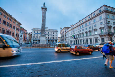 ROME, ITALY - JUNE 2014: Traffic along city streets on a summer day.