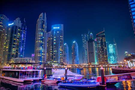 DUBAI, UAE - DECEMBER 6, 2016: Dubai Marina at night. city promenade. Skyscrapers along the canals.