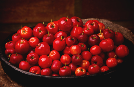 Acerola Red - tropical fruits in bowl Stock Photo