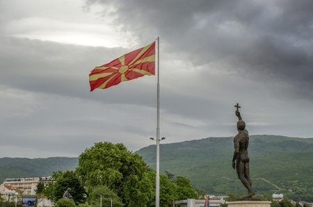 Macedonian flag with monument Epiphany in Ohrid, Macedonia