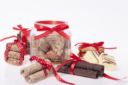 manjar: chocolate y una galleta como una delicadeza y decoraciones, Atención selectiva y poca profundidad de campo