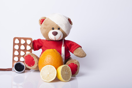 children's doctor: Bear Toy is ill, Selective focus and small depth of field Stock Photo