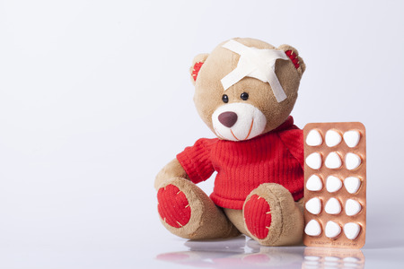 Bear Toy is ill, Selective focus and small depth of field Stock Photo