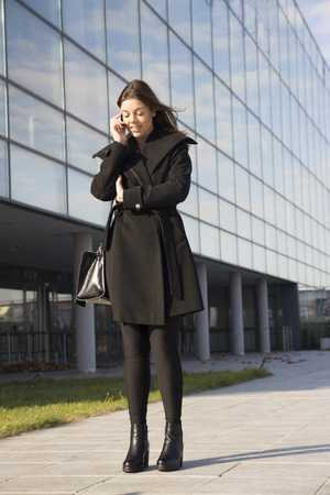 Young woman phoning with a mobile phone Stock Photo