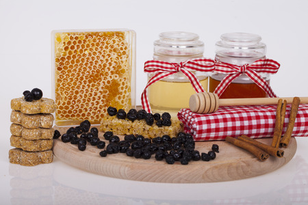 drizzler: Honey in  jar with honey dipper on a wooden background