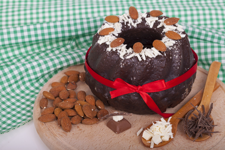 Very tasty chocolate cake on a wooden base