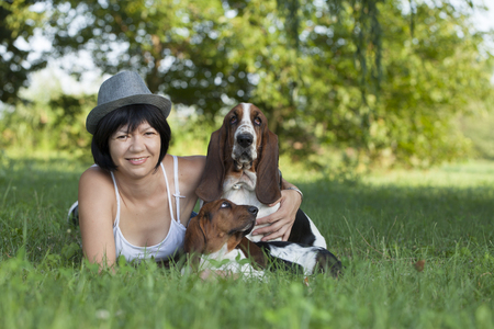 basset: The woman with the dogs in the countryside, Selective focus and small depth of field, lens flare