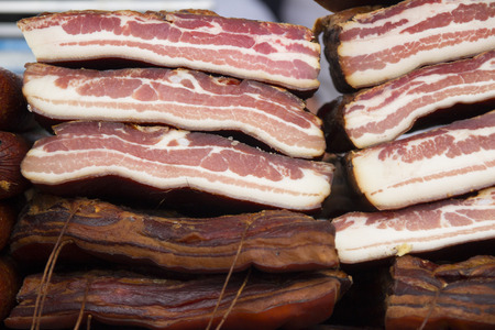 Home made smoked bacon in a street market