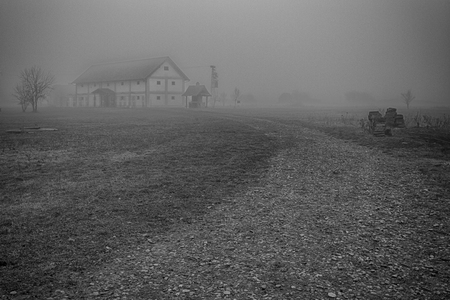farm in fog,  B&W, Selective focus and small depth of field, lens flare Stock Photo
