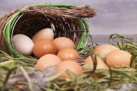 close range: Fresh organic eggs cooking on a wooden background.