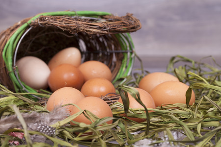 Fresh organic eggs cooking on a wooden background.