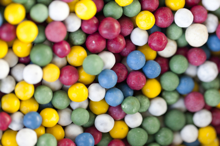 Very delicious sweet candies in various colors in the form of beads. Selective focus with shallow depth of field 版權商用圖片