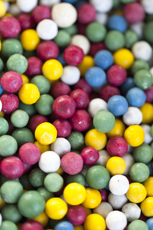 Very tasty sweet candy beautiful colors in the form of beads. Selective focus with shallow depth of field