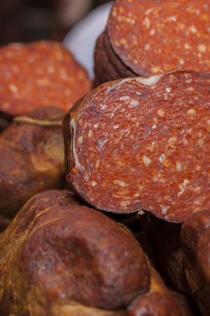 Fresh homemade smoked and dried sausage to eat at the market, selective focus and small depth of  field