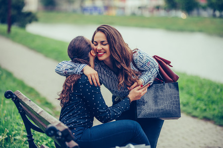 Happy meeting of two female friends hugging in the park - Image