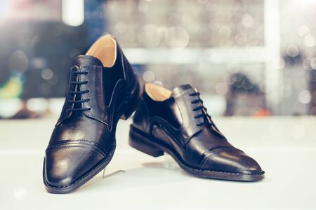 Pair of black elegant leather shoes on a shelf of a shop. Copy space. Stockfoto