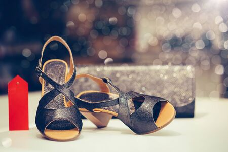 Close up shot of black elegant high heel women shoes or sandals , with woman purse. Concept of discount. Stockfoto