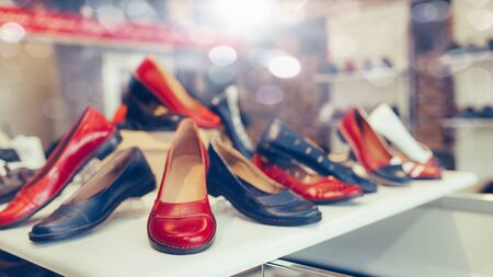 Women Classic Leather Shoes of different models and colors on the shelf at the shoe store. Stockfoto