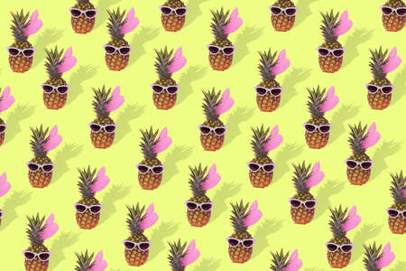 Trendy female pineapple hipster in sunglasses, pattern of stylish fruit. Minimal concept, summer tropical pineapples. Creative art fashionable vacation concept. Summertime color mood, pineapple.Fashion and trend.