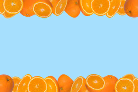 Frame of sliced fresh orange isolated on pastel blue background. Vitamins, healthy diet  concept. Minimal creative concept  fruit concept with free space for text.
