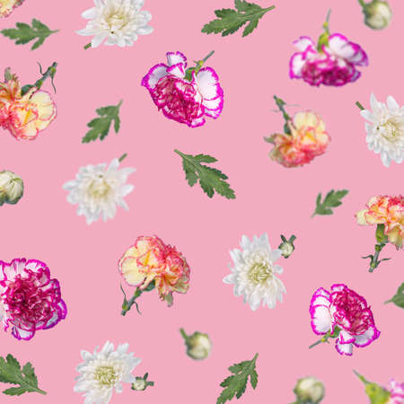 Beautiful spring or summer pattern made with various flying flowers and leaves on pastel pink background, trendy floral layout. Creative Minimal concept of nature, Birthday, Mother's, Valentines, Women's, Wedding Day.