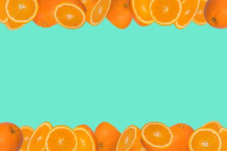 Frame of sliced fresh orange isolated on trendy green background. Vitamins, healthy diet  concept. Minimal creative concept  fruit concept with free space for text.