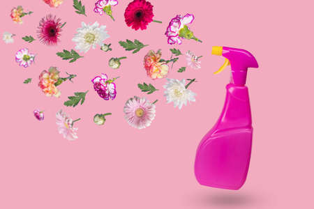 Creative minimal idea made from a bottle with a spray and various flowers flying in the air. The concept of protection, spring cleaning, disinfection and refreshment. Copy space Standard-Bild