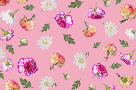 Spring or summer pattern made with different flying flowers and leaves on a pastel pink background, trendy floral layout. Creative Minimal concept of nature, Birthday, Mother's, Valentines, Women's, Wedding Day.