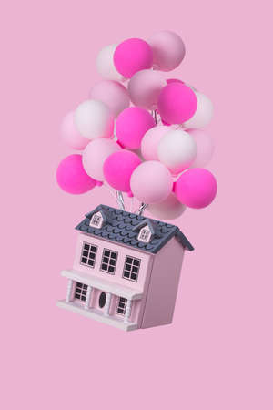 Creative idea with a house with a lot of colorful balloons flying in the air. Minimal concept for advertising, marketing or artwork design.