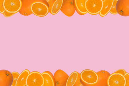 Frame of sliced fresh orange isolated on light pink background. Vitamins, healthy diet  concept. Minimal creative concept  fruit concept with free space for text.