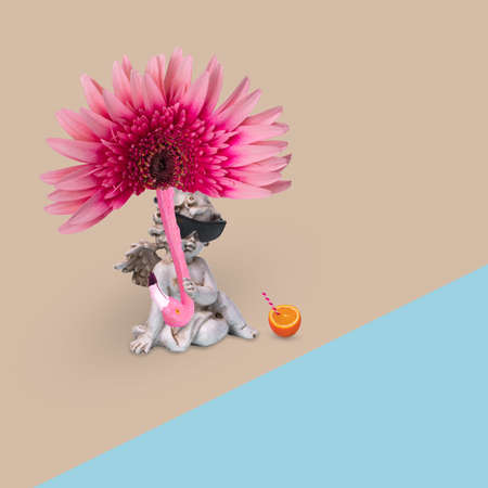 Creative minimal fun idea with a happy angel in sunglasses with sun umbrella of flower and flamingo, enjoying on the beach. Funny pop art design. Creative concept of holiday, travel and enjoyment.