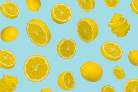 Floating levitating fresh lemon on pastel blue background. Vitamins, healthy diet concept. Minimal fruit idea. Sliced lemon floating in the air. Creative concept with flying fruits for advertising, marketing or artwork design. Standard-Bild