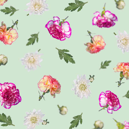 Trendy floral pattern made with different flying flowers and leaves on mint green background. Creative Minimal concept of nature, Birthday, Mother's, Valentines, Women's, Wedding Day. Standard-Bild