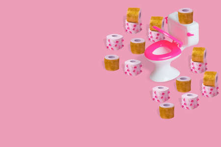 Creative idea with toilet bowl, toilet paper with diamonds and glitter on a pink background. Minimal concept of fashion, luxury, expensive life. Copy space