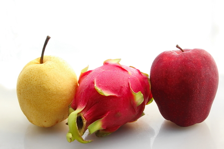 pitaya: red apple pitaya and pear on white background