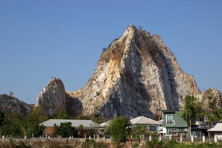 resident: resident beside rock hill in Thailand