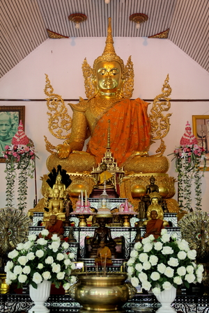 dhamma: generally in Thailand any kind of art decoreted in buddhist church or temple area etc. created with donated by people to hire artist they are public domain .No restrict in copy of use ,no name of artist appear and not copyright Editorial
