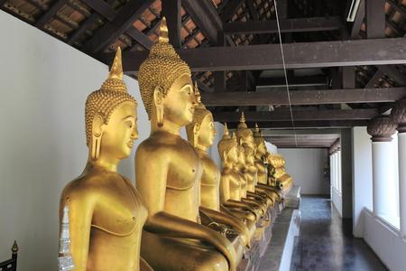 dhamma: row of golden buddha statue Stock Photo