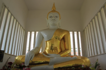 dhamma: White buddha statue and gold cloth