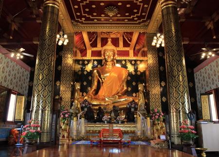 dhamma: Gold buddhist statue in the church Editorial
