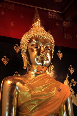 dhamma: Close up of golden buddhist statue Stock Photo