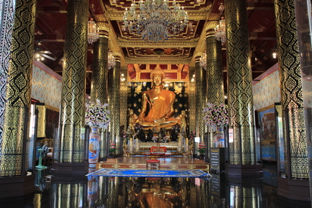dhamma: Gold buddhist statue in Thailand traditional church