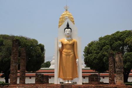 dhamma: standing buddha statue on sky background Stock Photo