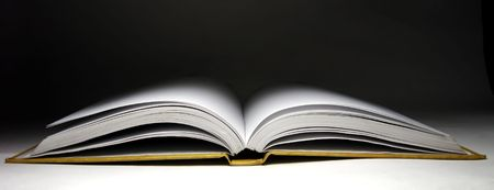 A blank open diary in dark background. photo